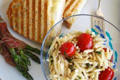 his Pasta Salad is one that islight and easy~ adapted from The Fresh Market's deli department. . . cook your orzo according to the packagedirections. Add to taste: capers, toasted pine nuts,lemon juice & zest, chopped basil, parmesan, grape tomatoes& Newman's Own Parmesan & Roasted Garlic Dressing.