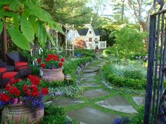 The enchanting path to this playhouse winds past colorful plantings.