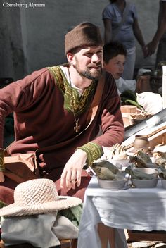 12th century merchant at Lenzburg 2013. Comthurey Alpinum, 12th century Medieval Reenactment 1180 ad.