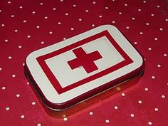 First Aid Kit-formerly known as Altoid Tin. Spray paint and cover, accordingly. Store bandaids, Tylenol, tweezers, safety-pins, cash, ointment packets, etc.