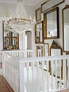 Hall of Mirrors.  In the stair hall, daylight bounces off a Dutch chandelier and assorted mirrors.