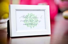 Fill the table with inspirational quotes about motherhood for a special touch.