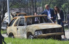 Britain's Prince William and his wife Catherine, the Duchess of Cambridge, look at the damage left after a forest fire in Slave Lake, Alberta, on July 6, 2011. The town posted a brief letter from  Prince William and Catherine, the Duchess of Cambridge, on its website Tuesday, May 22. Photo by: Andy Clark, Reuters