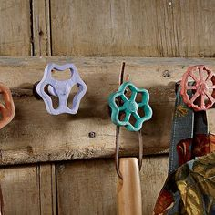 Old faucets, painted and turned into hooks for organizing a shed or outside space