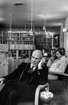 Poet Archibald MacLeish listening to a recording at the Harvard University Library. MA, US, 1957.