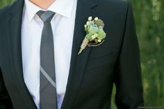 A simple succulent boutonniere. Floral design by Violetta. Photo credit, Troy Grover Photographers.