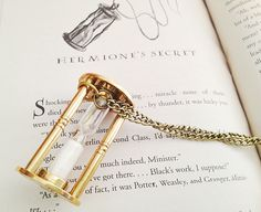 Hermione's Time Turner Necklace. Hourglass Pendant. Sand. Harry Potter Jewelry. Wizard. Fantasy. Long Necklace. Vintage Style. Brass. Magic.. $44.00, via Etsy.
