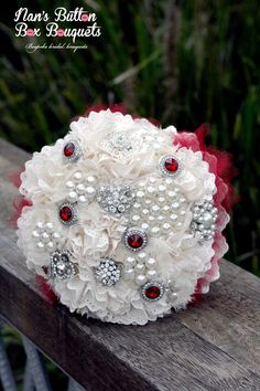 The pops of red in this ivory alternative wedding bouquet really make the bouquet pop and tied in perfectly with the red colour scheme.