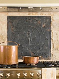 Add an antique tiling to the kitchen. Perfect with the rustic copper and metal.