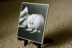 DIY Ceramic Tile Photo • 1 6x6 white ceramic tile  • 1 photo cut to slightly smaller than 6x6  • 1 stand of your choice.  • Matte Mod Podge  • Foam craft brush