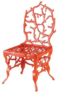 coral chair  would look good against a sea blue wall