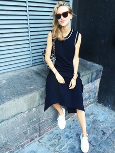 Pernille Teisbaek is on point with the ultimate street style look of fresh white sneakers and a sleek navy dress with white trim. // #Fashion