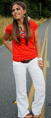 Red t-shirt, white pants, turquoise necklace
