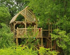 Yogan's Timber Frame Cabin in the Trees (France).  Love the curve of the roof.