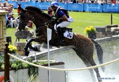 Aurelien Kahn of France competes during the cross-country match of equestrian event at London 2012 Olympic Games, London, Britain, July 30, 2012. (Xinhua/Gaesang Dawa)