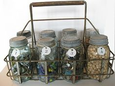 Old Rusty Milk Bottle Carrier...old canning jars with zinc lids.