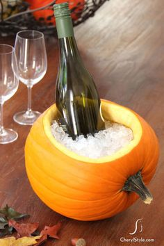 Fill a scooped out pumpkin with ice for the perfect place to cool beverages at your next party. For the best results, look for a pumpkin that can lay flat on its side. Click through for the tutorial and more interesting ways to use a pumpkin at this year's Halloween party.