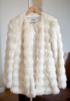 white faux fur coat - perfect for winter with some skinnies.
