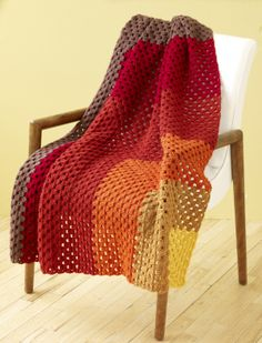Blanket - gorgeous autumnal colours must learn to crochet. Wonder if I could knit as a mitred square?