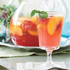 Carolina Peach Sangria—Peaches put a Southern twist on this classic sparkling cocktail. Make the sangria the day before to allow the flavors to blend. Garnish with fresh mint. | SouthernLiving.com