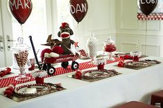 Sock Monkey Party: Each guest was given a personalized balloon as a seating assignment, their own sock monkey, and perfectly packaged lunches filled with mouth-watering desserts.  {Birthday Party Express}