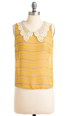 Mustard and blue print sleeveless blouse with pretty lace collar detail. #vintage #fashion #lace #collar