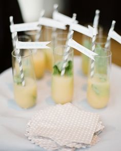 """Basil gin martinis made even more festive with """"Eat, Drink, Marry"""" straw flags"""