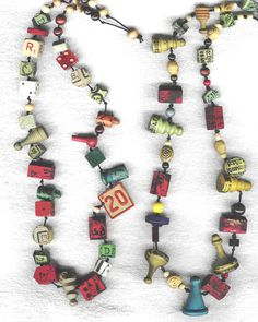 Vintage game piece garland!  Ohh what I could do!