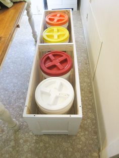 DIY Bench Seat that stores five gallon buckets of food storage