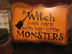 A Witch Lives Here with her little Monsters HALLOWEEN Wood Sign Plaque in Pine NEW. $14.99, via Etsy.