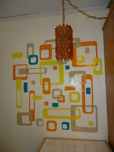 Mid-Mod kitchen wall with vintage diamond-pattern lucite hanging swag lamp.