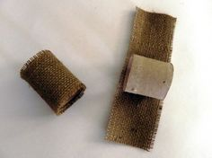 Wrapping the toilet paper tube with burlap to make napkin rings