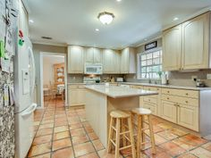 Custom Kitchen with Center Aisle, Custom Cabinetry, Wall Oven, Opens to Family Room