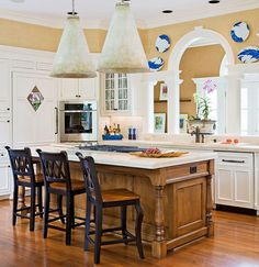 Like the stools. Oversized cone lanterns command this kitchen