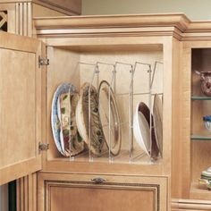 Organization tip: Use a chrome shelf organizer to create vertical storage for platters, large plates, and cookie sheets!