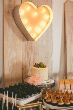 heart marquee over the dessert table