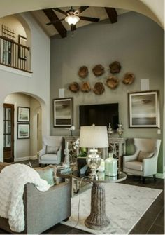 Exquisite #livingroom #design with a  #cathedral #ceiling, dark #hardwood #floors and #wood #accent #decor. #furniture #couch