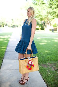 Awesome summer style via The Style Scribe. <3 the pleated dress and great bag!