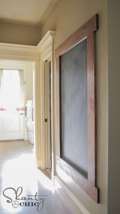DIY:  Framed Chalkboard Wall Tutorial - this shows how to construct the frame + how to prep & paint the wall with chalkboard paint.  The painted wall concept would also work if you have an unused frame.