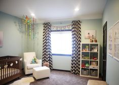 Modern Girl's Nursery - the #chevron drapes make such an impact!