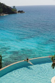 Just a few steps from the beach, Four Seasons Resort Seychelles' pool has plenty of room to decompress away from the sand and surf