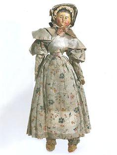 Rare papier mâché doll with original clothing, c.1830
