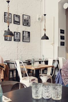 This cafe looks like it has a modern look with a vintage feel. The vintage looking interior helps bring a cafe feel to the interior.