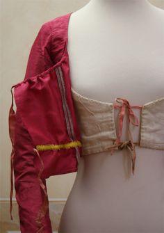 """1795 Abiti Antichi. """"Corpetto in taffetà marezzato rosa scuro. Manca di uno dei due pannellini frontali."""" Google translate: """"Bodice Taffeta marbled pink. Missing one of the two small panels front."""""""
