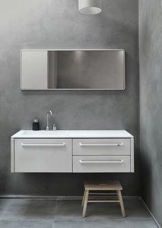 Un meuble vasque très design avec une touche rétro grâce à son miroir arrondi