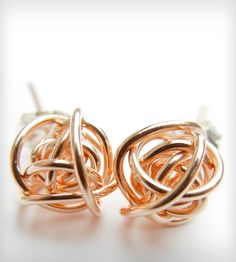 Love Knot Stud Earrings   A tiny reminder of all the twists and turns taken on the rolle...   Earrings
