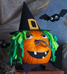 Witch Pumpkin How-To ~ A twisted pumpkin stem doubles as a crooked nose for this sparkly witch.