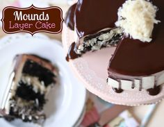Mounds Layer Cake - layers of chocolate cake, Mounds bar filling, and coconut frosting with chocolate ganache.  One of the most popular recipes on my site!!