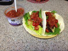 Quinoa black bean tacos! Vegan, just quinoa cooked in vegetable broth (2 C veg broth per 1 C quinoa), black beans, romaine, halved cherry tomatoes, tortillas, and organic salsa. Delicious! And soooo easy.