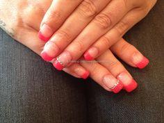 Acrylic overlay with pink gel polish on tips with diamonties on ring xx